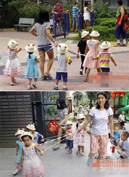 西安家庭式幼儿园遛孩子 幼儿被拴绳玩耍