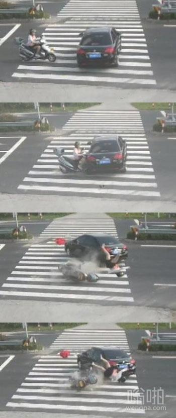 女子骑车看手机撞到轿车 上演空中芭蕾