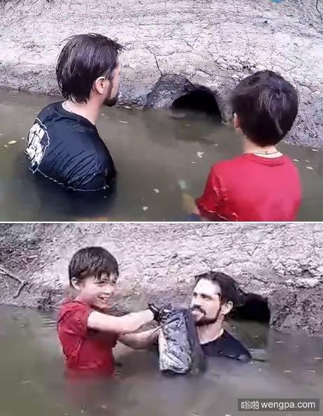 父子湖边发现一个小洞 确从里边掏出大家伙