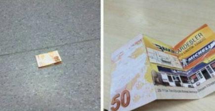 """老外也学会了这招 地上50""""欧元""""背面印的是广告 坑爹啊"""