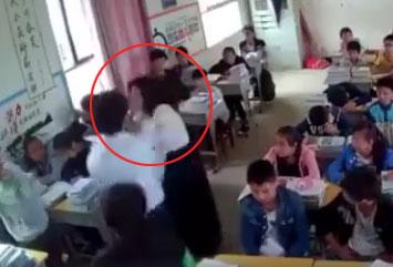 男生遭女老师扇耳光 当场猛扇回击(视频截图)